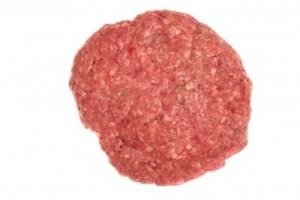 a raw hamburger patty