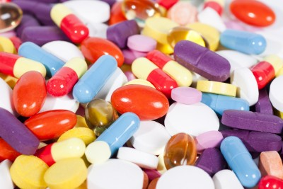 a pile of pills in different colors