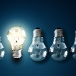 3illuminated light bulb in a row of dim ones concept for creativity, innovation and solution