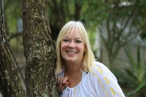 Jan Hull standing next to a tree