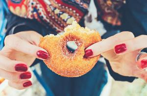 a woman eating a donut