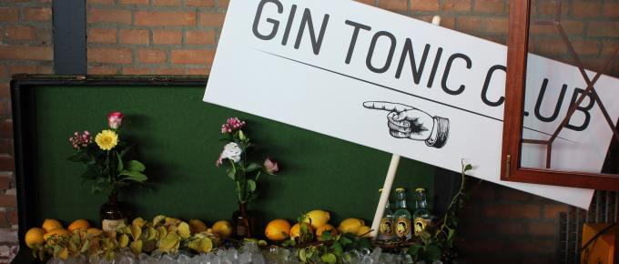 a sign that says gin tonic club