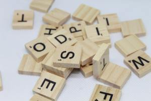 scrabble pieces piled on a table