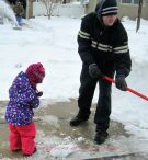 Daddy shoveling, while Emma Plays!!