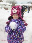 Emma so proud of handiwork on this snow ball!!
