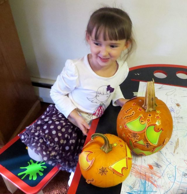 Emma Proudly Showing Off Her Pumpkins!