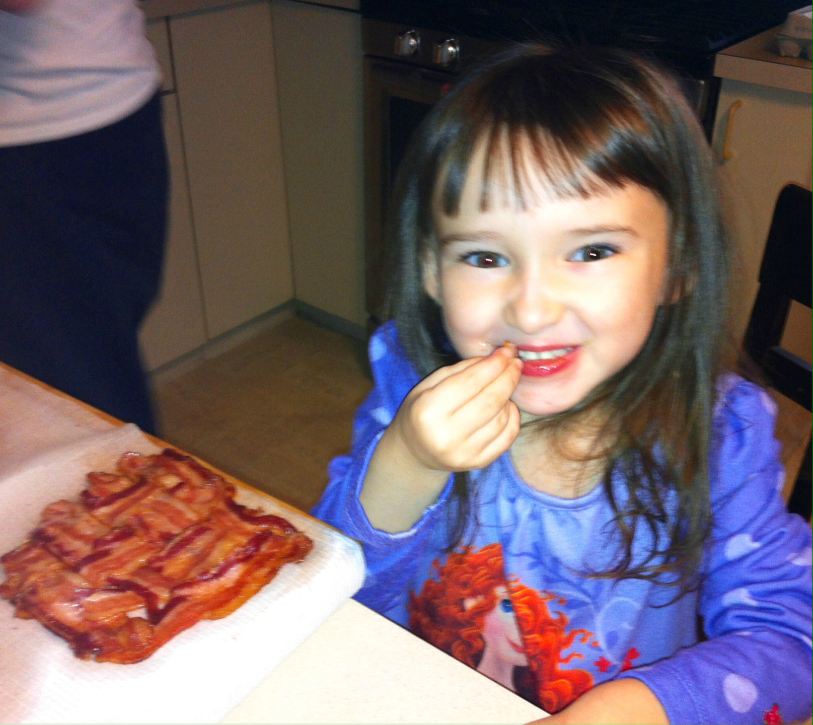 What does exactly does Emma eating tasty bacon have to do with Coach Daddy?
