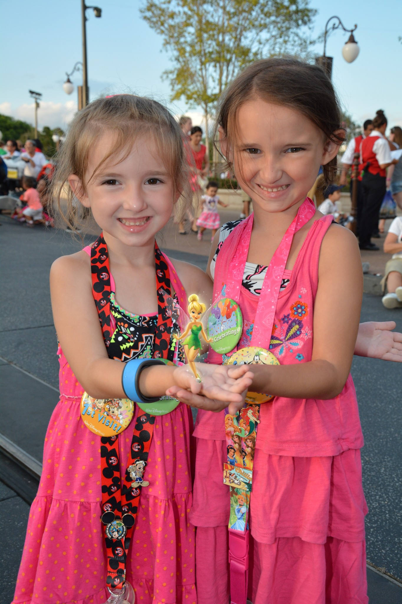 The girls visiting the Magic Kingdom with Tinker Bell