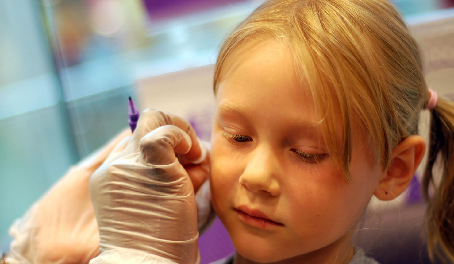 Little Girl Getting Her Ears Pierced