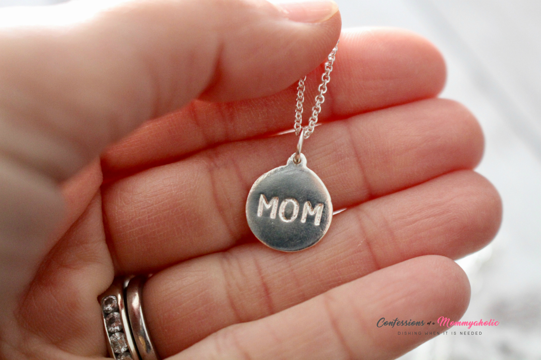 Helen Ficalora Mom Necklace In Hand