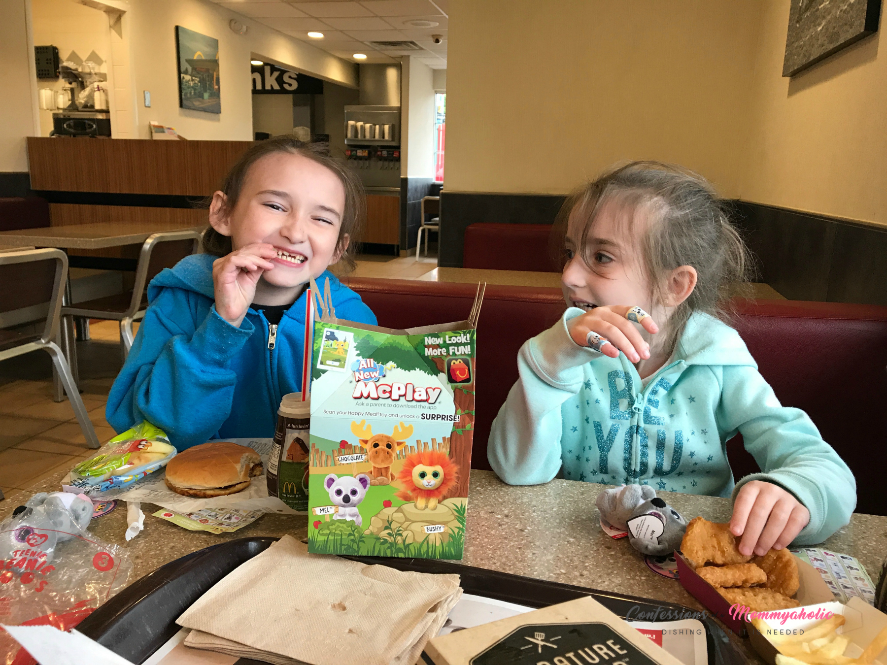 Kids eating McDonald's Happy Meals