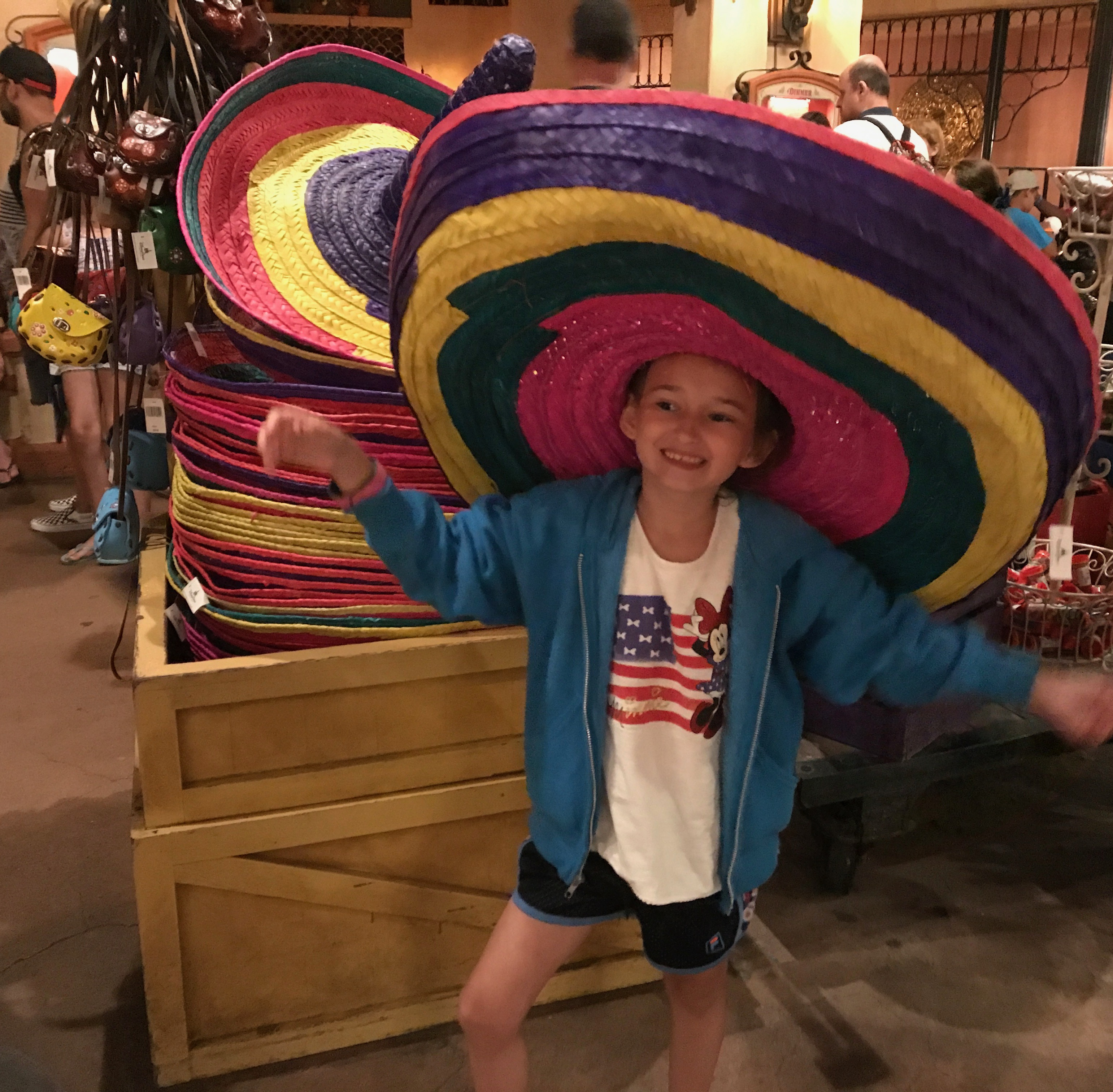Shopping at Epcot in The Mexican Market wearing a Sombrero