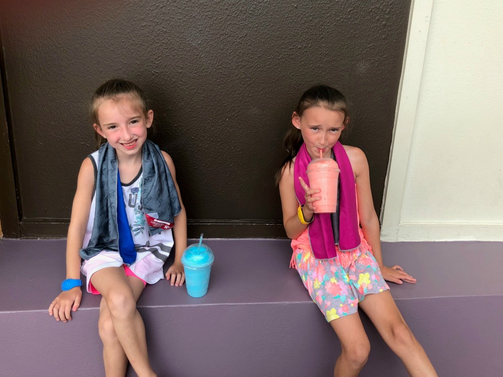 Drinking Secret Birthday Slushies in Front of Club Cool in Walt Disney World Epcot