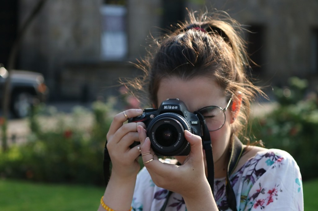 Young Girl with Nikon Camera