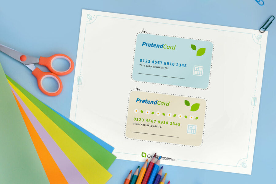 pretend-card-on-blue-desk-with-scissors-900x600