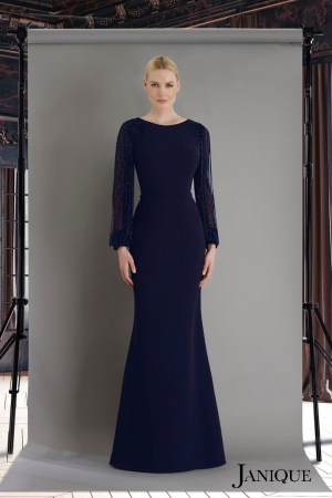 Fringe beaded sleeve evening gown in navy. Long sleeve jersey dress by janique. Navy long dress with beaded long sleeves.