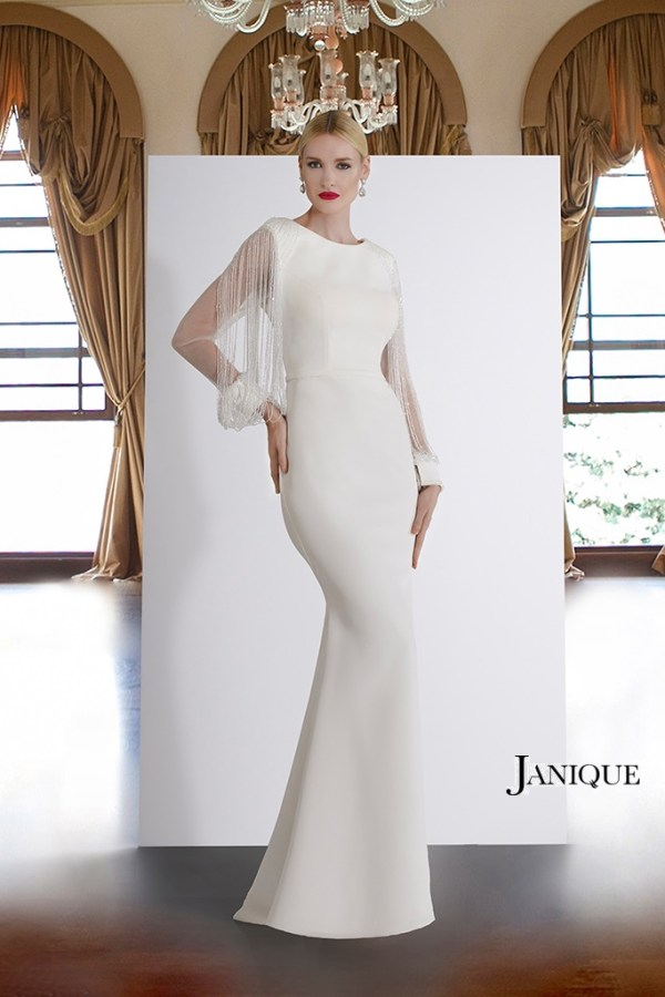 Long dress for MOB in white by Janique. Modest dress with beaded fringe sleeve. Stretch crepe gown with beaded sleeves.