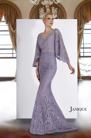 Modest long sleeve lavender gown. Encrusted neckline lace long dress by Janique in lilac. Flared sleeves mob long lace gown.