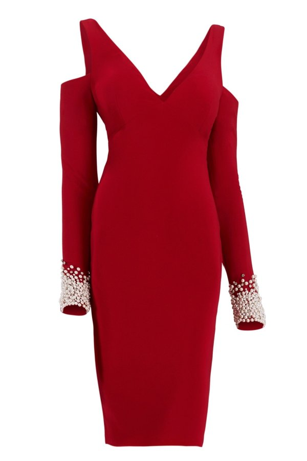 Short dress with shoulder strap and pearl cuffs sleeves. Cocktail dress by Janique in red with long sleeves pearl cuffs.