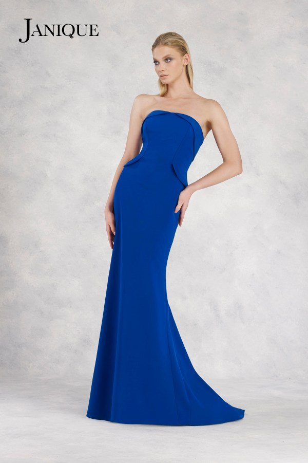 Tuxedo strapless folded neckline and side peplum dress. Royal stretch crepe dress with tuxedo top and side peplum by Janique.