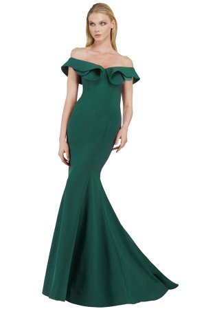 Designer stretch crepe long gown with train in green. Off the shoulder long dress. Ruffled neckline off the shoulder gown.