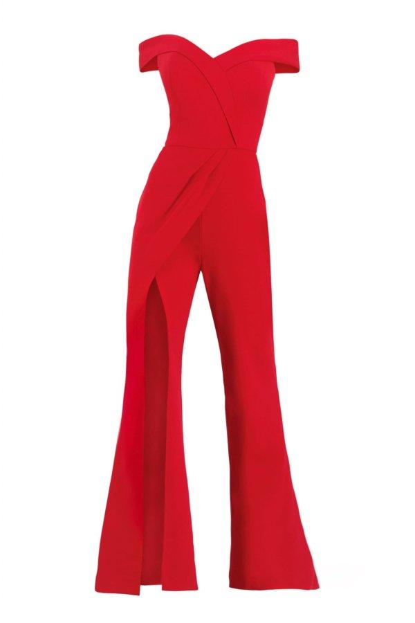 Off the shoulder red jumpsuit. Jumpsuit with slit by Janique in red off the shoulder. Red jumpsuit off the shoulder.