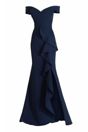 Couture long dress in navy with ruffled slit skirt by Janique. Off shoulder ruffled high slit designer gown in navy.