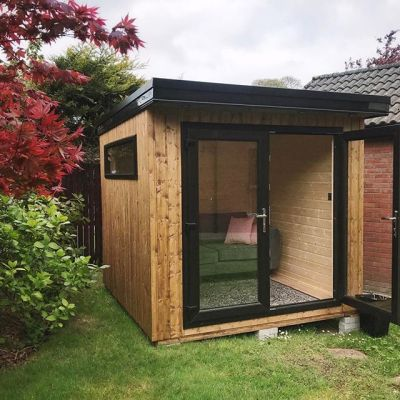 Progress on the shed …. electricity and a sofa!