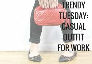 Casual outfit for work with denim jeans, cream sweater, black vest, bold accessories including a red clutch and leopard flats. Cute womens outfit.