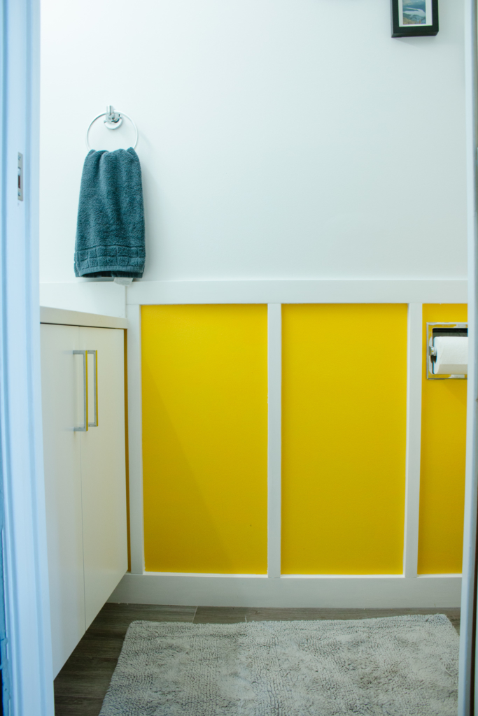 DIY Board and Batten Bathroom Wall for yellow and white bathroom makeover
