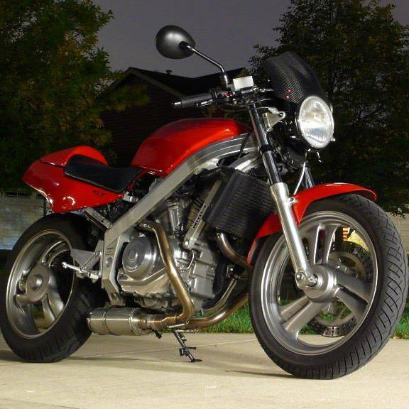 A nighttime shot of a lightly modified Honda Hawk GT 650 motorcycle