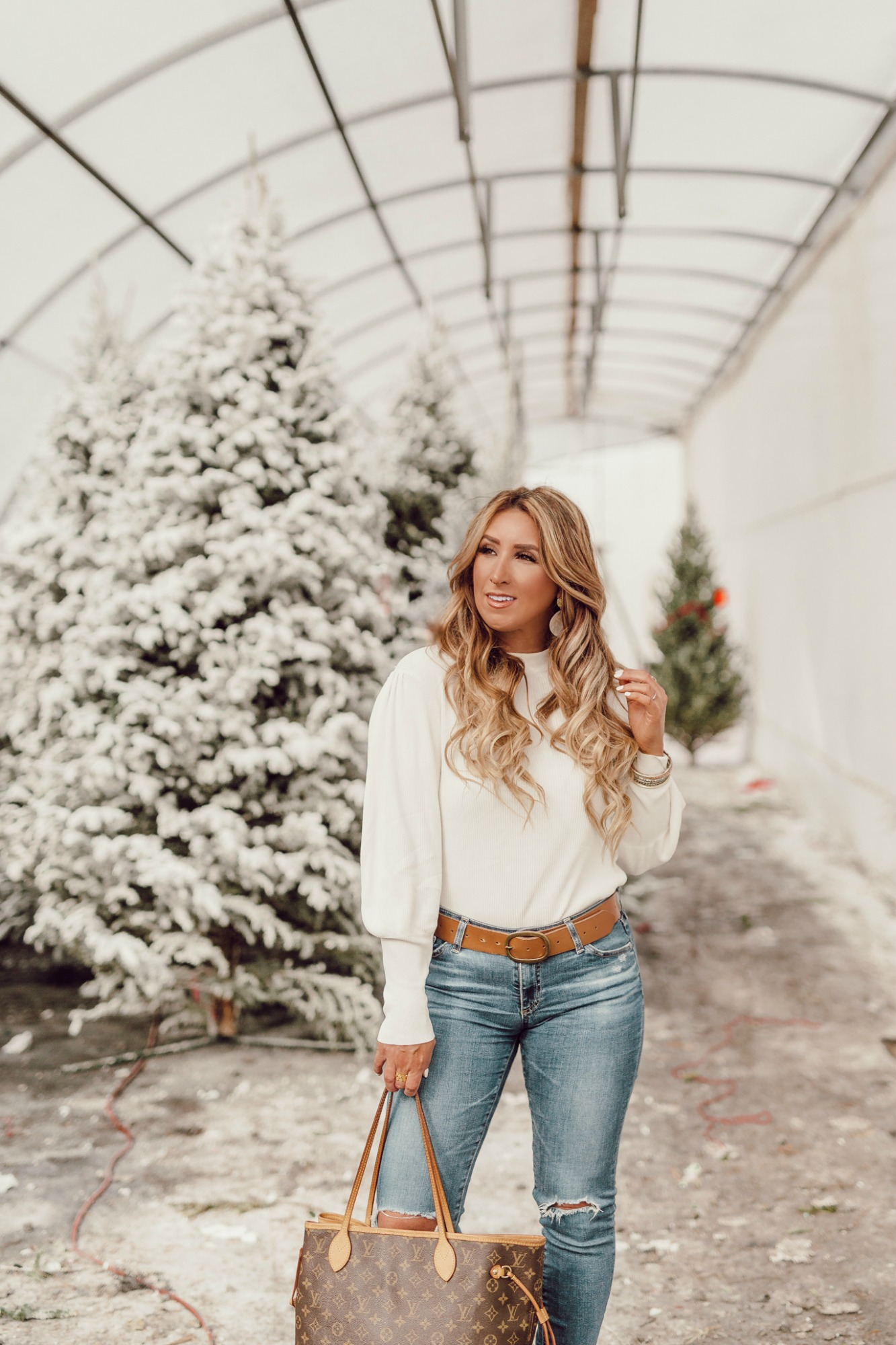 Casual holiday outfit idea with white boots