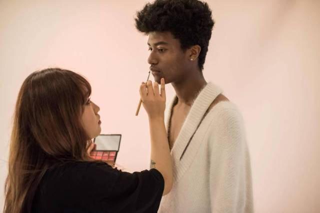South Korean model Han Hyun-min has makeup applied as he prepares for a photo shoot at a studio in Seoul on Friday.