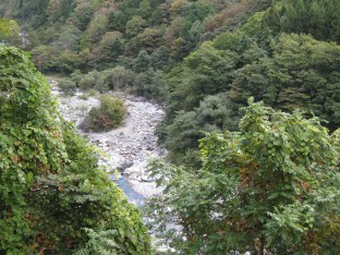 huge rotenburo is downhill beside a stream