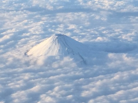Mt Fuji floating on a sea of clouds - taken on the plane