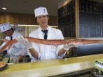 sushi chef showing long fish !