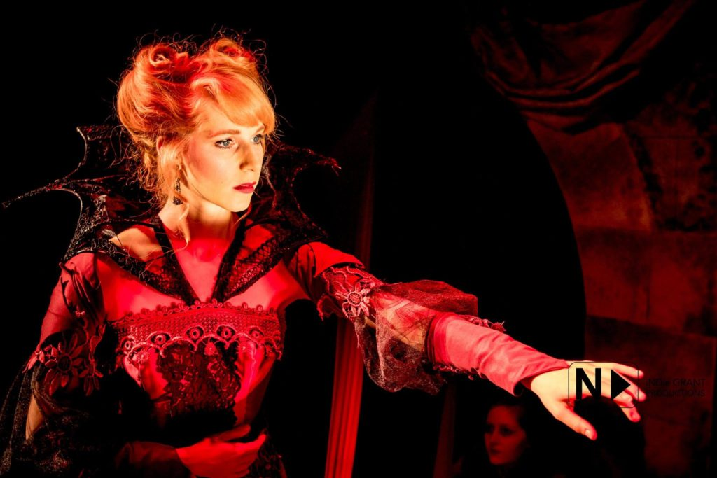 """The Gods are beautiful and powerful / And through such blessings display their Favorites."" Mary-Kate Arnold as Countess Bathory. Costumes by Delena Bradley. Lighting by Benjamin Dionysus. Photo by iNDie Grant Productions."