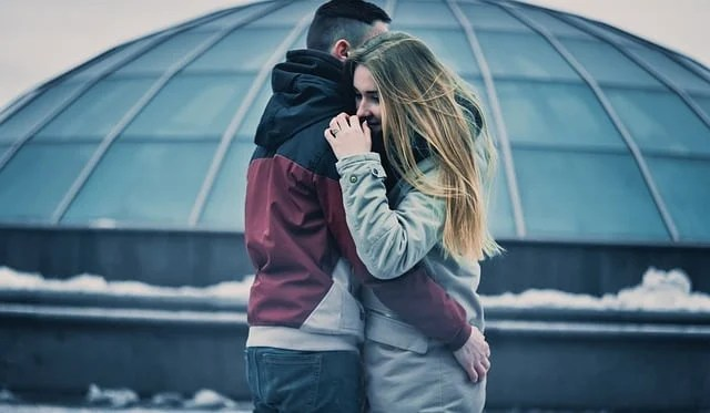 couple embracing outside