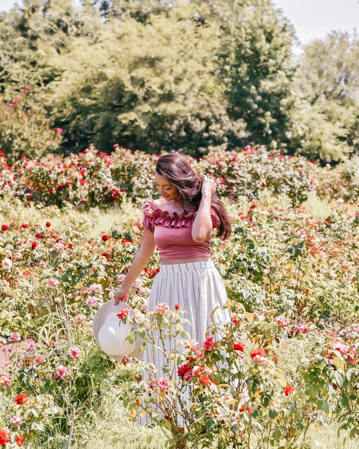 girl among roses