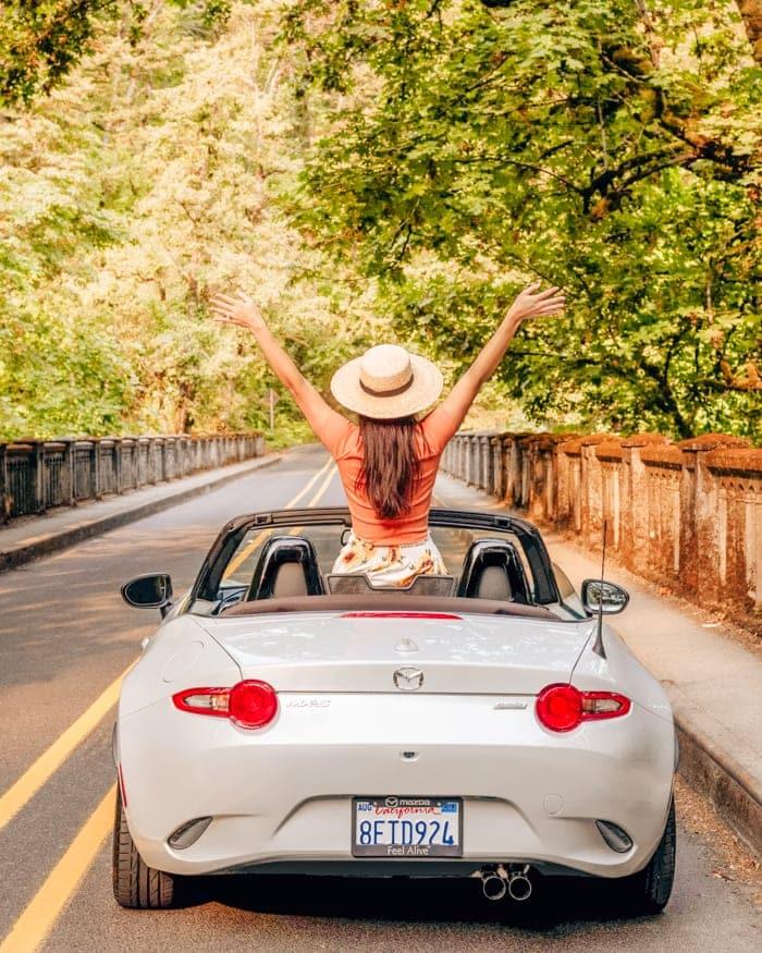 girl in miata convertible