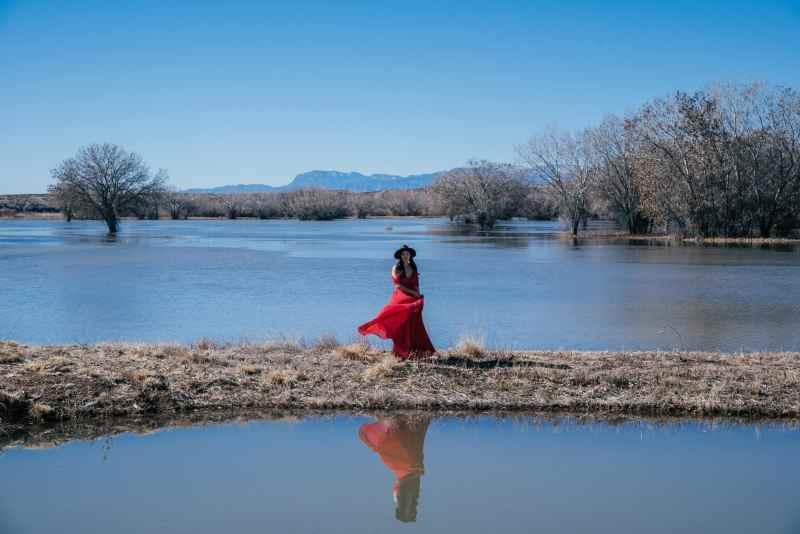 girl at bosque del apache mirror lake