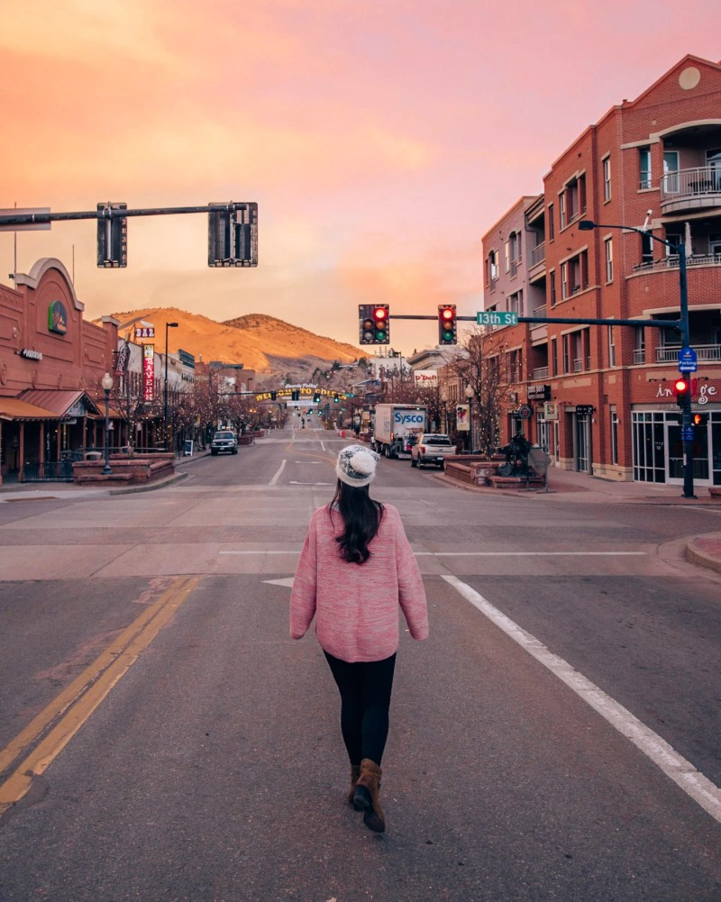 Pink sunrise from main street in Golden, Colorado - one of many hidden gems near Denver.