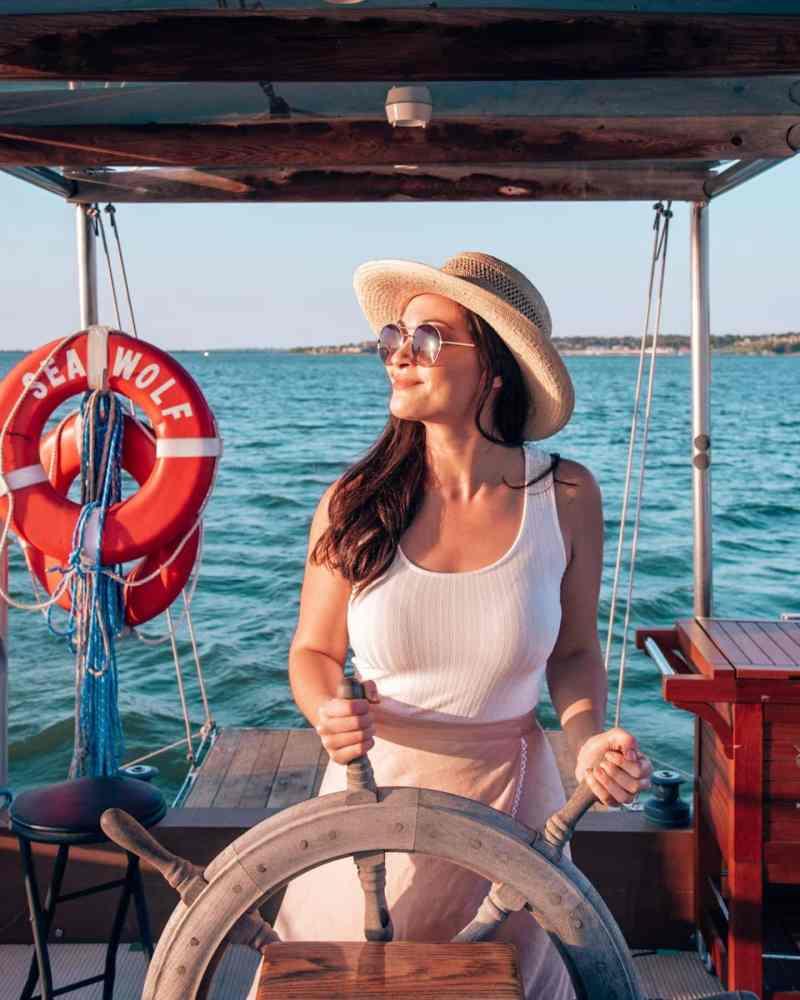 girl at wheel of boat