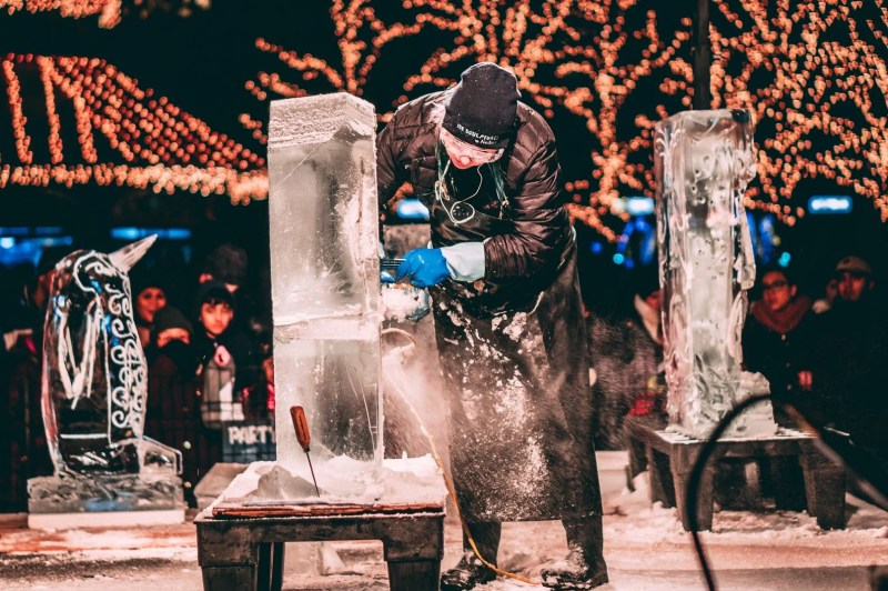 person carving ice sculptures