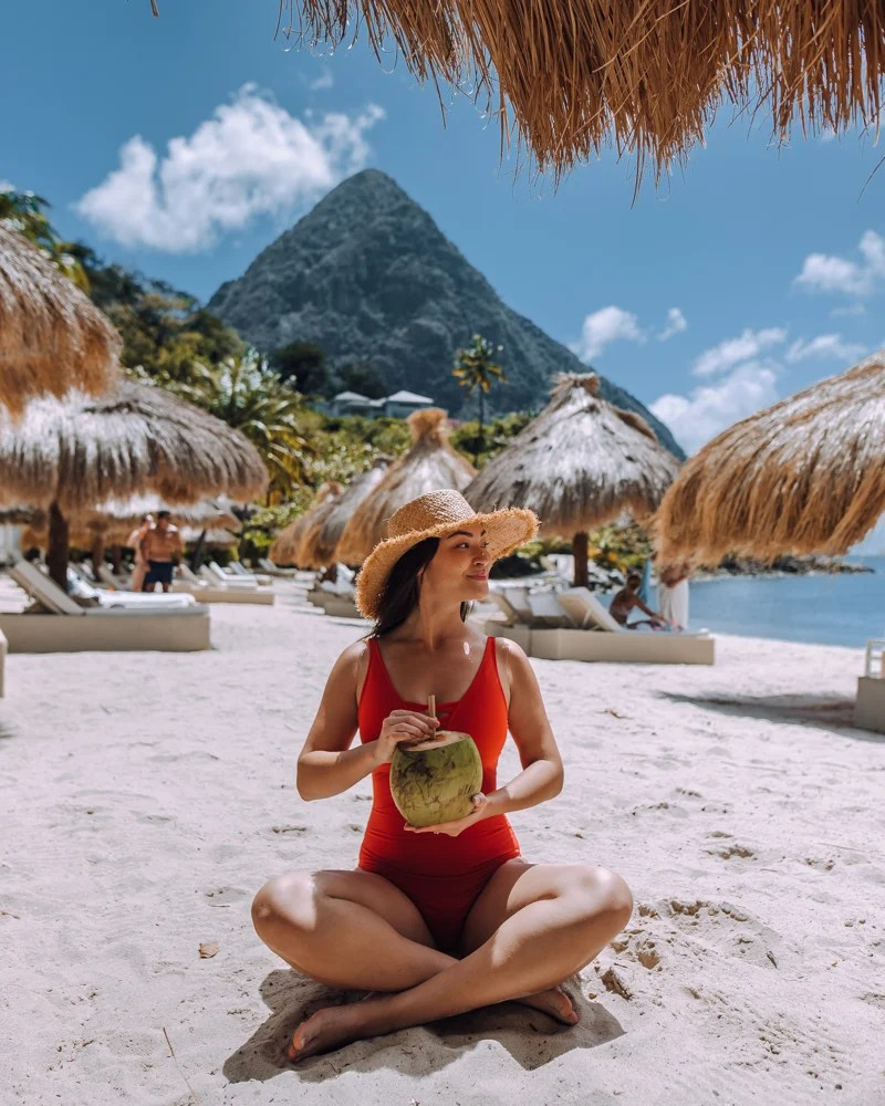 girl drinking coconut water on the beach