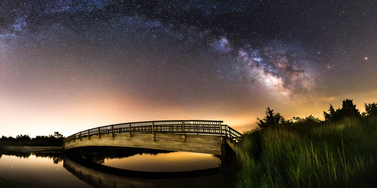 Milky Way spanning over a bridge