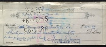 A 60-year-old check my dad made out in his elegant Palmer-method handwriting