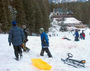 Sledding behind Fairmont Banff Springs in the Canadian Rockies.