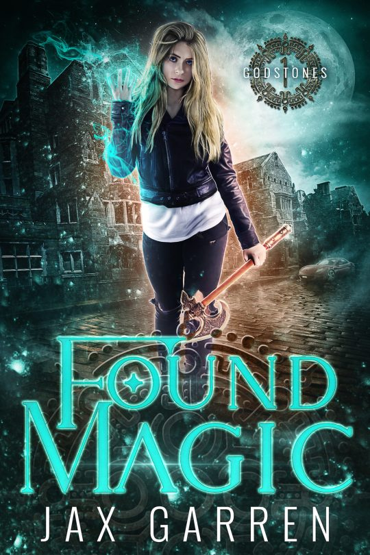 Book cover of Found Magic. A modern woman with magic in one hand and an ax in the other.