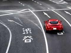 red jdm car on the road